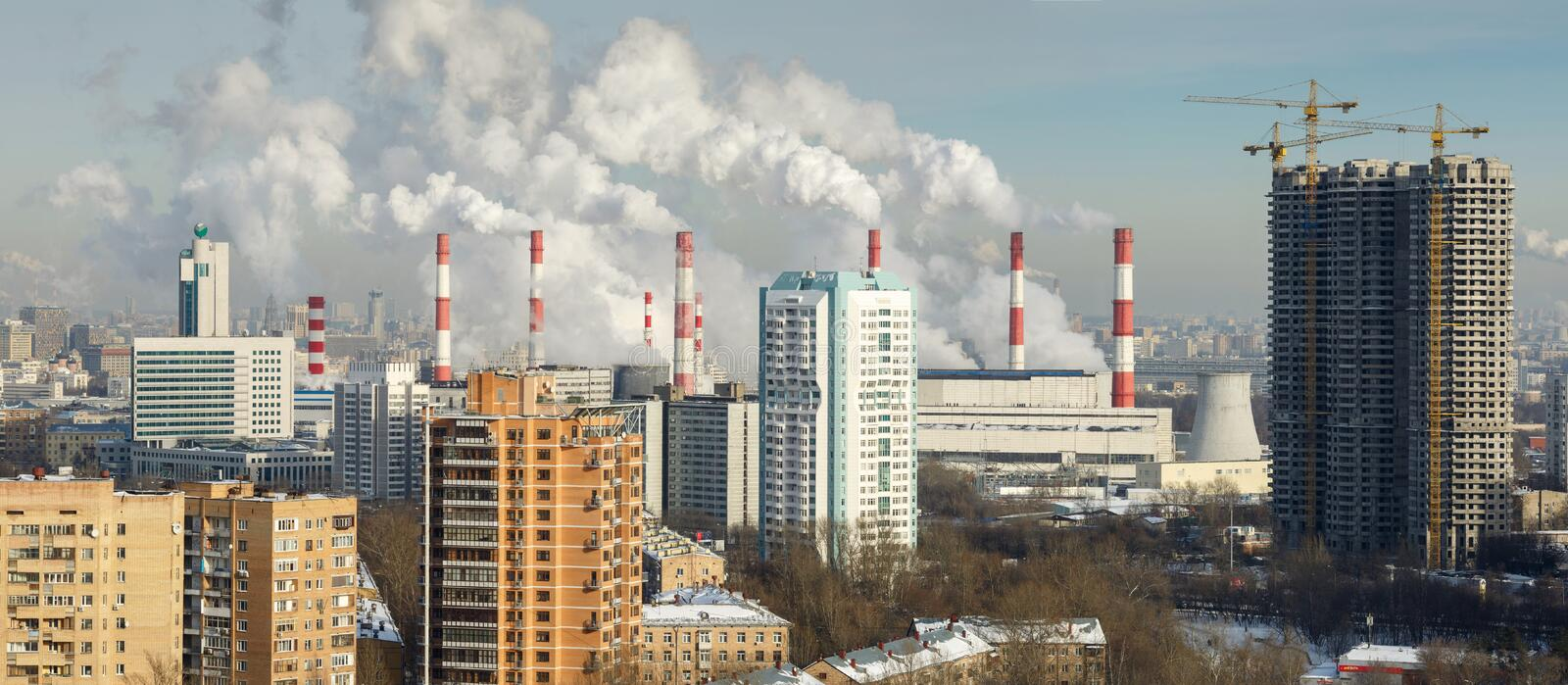 Chimneys of the combined heat and power plant. Moscow, Russia royalty free stock photo