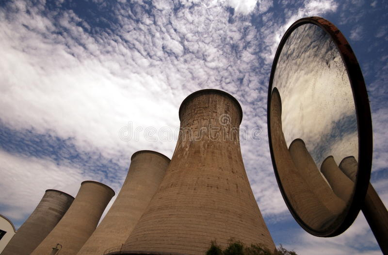 Chimneys of a geothermal power plant. In italy royalty free stock photo