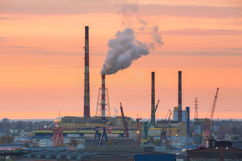 Chimneys of heating plant in Gdansk. At sunset, Poland royalty free stock photos