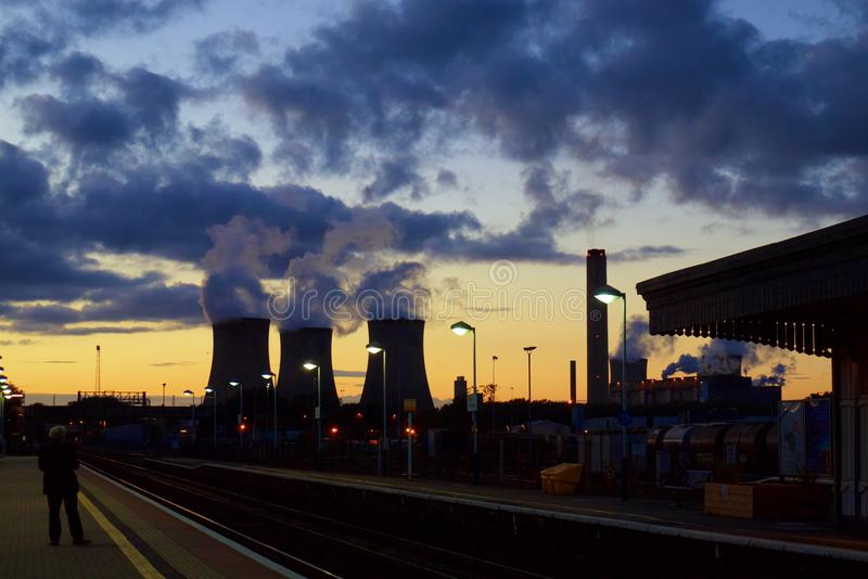 Chimneys of nuclear power plant at dusk. This shot was taken from a train station platform overlooking a nuclear power plant chimneys in England royalty free stock image