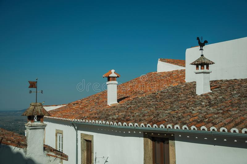 Chimneys over rooftop of old houses in Marvao royalty free stock image