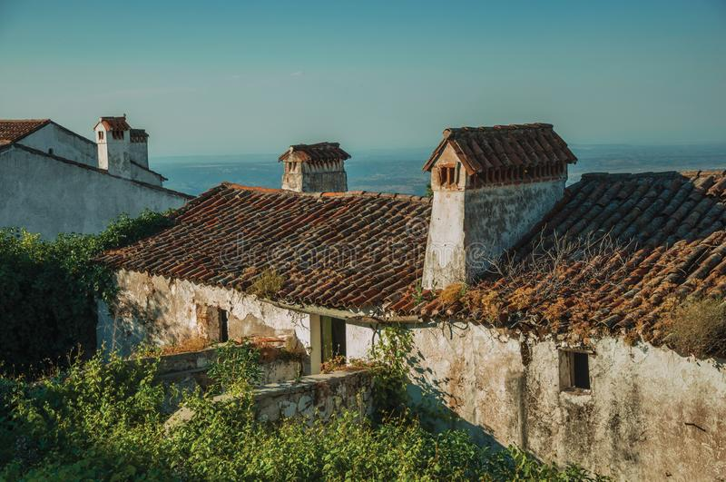 Chimneys over rooftop of a worn old house in Marvao royalty free stock image