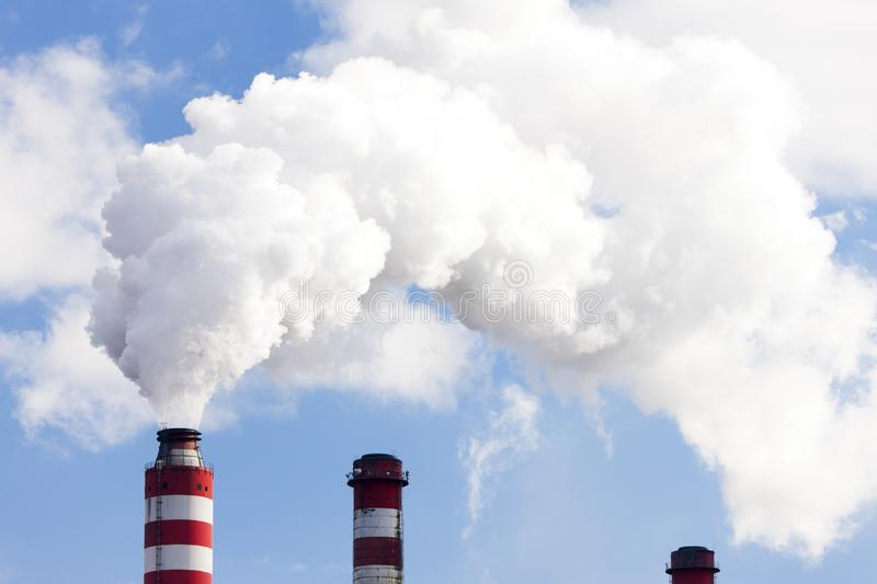 Chimneys of power plant. Outdoors, outside, exteriors, industry, industrial, energy, energetics, production, electricity, generation, station, house royalty free stock photos