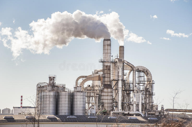 Chimneys and silos of a factory. royalty free stock photo