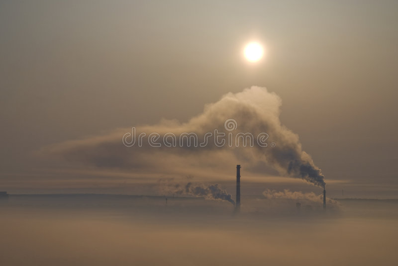Chimneys and smog covered city royalty free stock photography