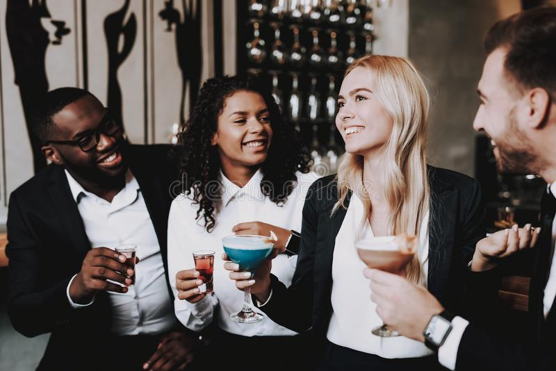 Chin-Chin. Girls and Guys. Bar. Drink. Clubbing. royalty free stock images