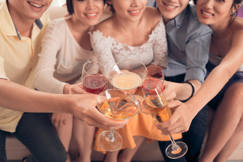 Chin-Chin. People clinking glasses with cocktail stock image