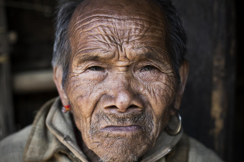 Chin tribe man. MINDAT, MYANMAR - DECEMBER 8: Elderly Chin man poses for a photo on December 8, 2015 Mindat, Myanmar. Chin people, also known as the Kukis are a stock photos