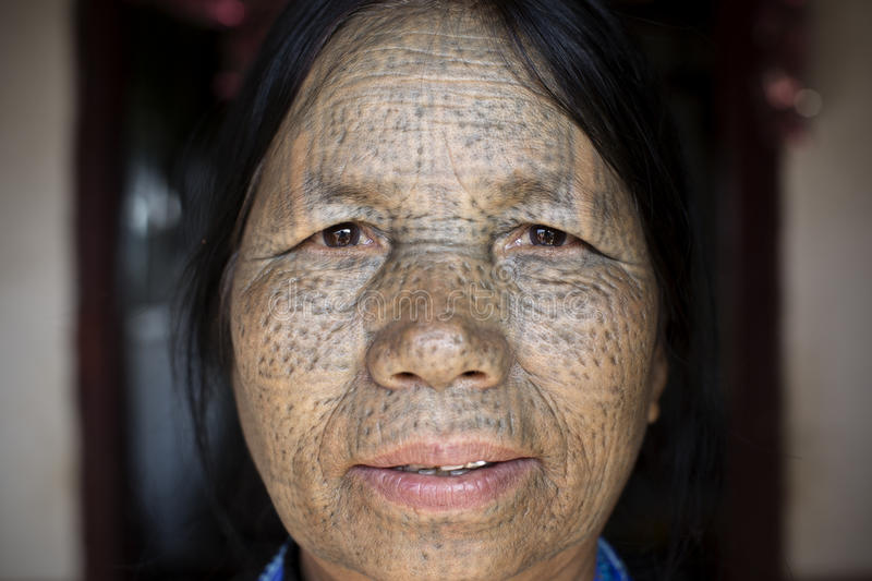Chin tribe tattoed woman (Daai). KANPETLET, MYANMAR, DECEMBER 10: Chin tribe tattooed woman (Daai) poses for photo on December 10, 2015 Kanpetlet, Myanmar. Also royalty free stock images