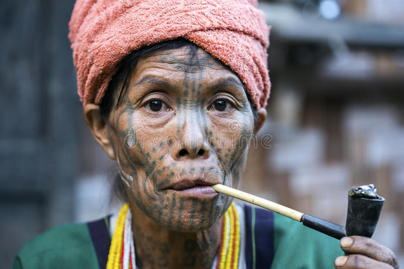 Chin tribe tattooed woman (Muun). MINDAT, MYANMAR - DECEMBER 7: Chin tribe tattooed woman (Muun) poses for a photo on December 7, 2015 Mindat, Myanmar. Chin stock images