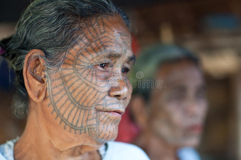 Chin Tribe woman, Myanmar. Portrait of Chin tribe tattooed old woman on January 04, 2012 in Mrauk U, Myanmar stock images