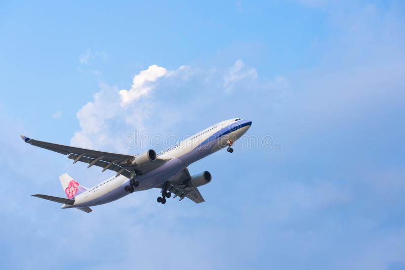China Airlines plane lands. HO CHI MINH, VIETNAM - MAY 28, 2015: An unidentified plane of the China airlines approaches the Tan Son Nhat Airport. China Airlines stock photo