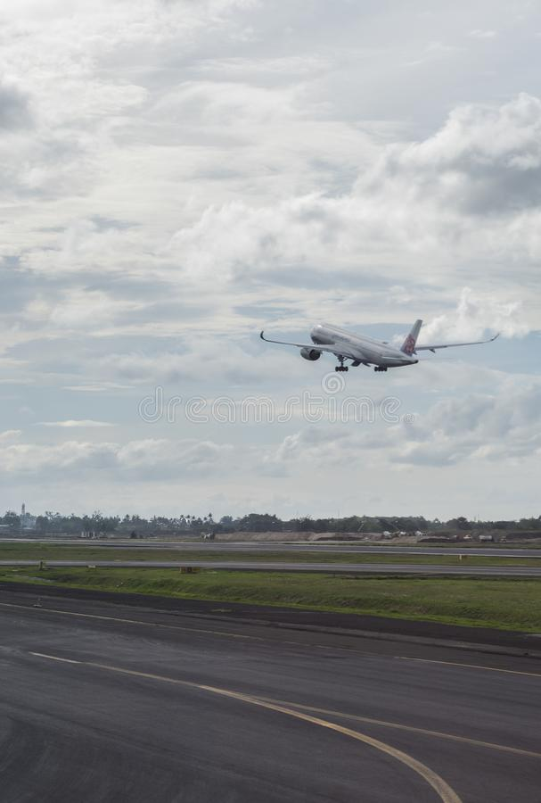 China Airlines plane takes off from Soekarno-Hatta International Airport in Jakarta, Indonesia.  royalty free stock image