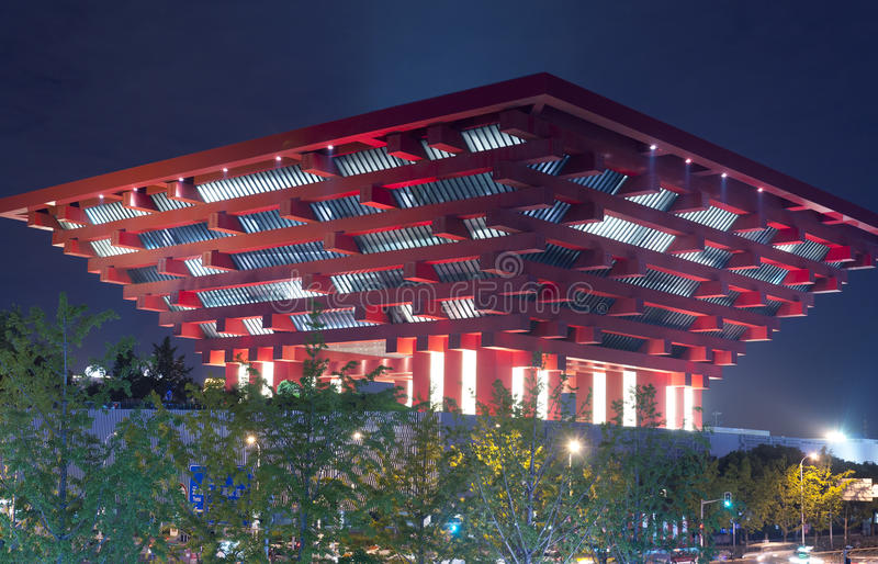 China Art Palace. The unique architecturally designed China Art Museum lit up at night in Shanghai China stock photos