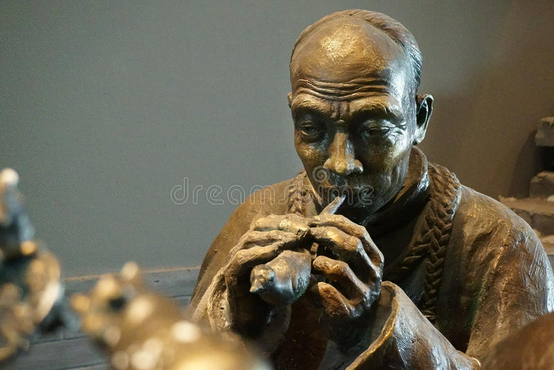 China Asia, Beijing, the capital museum, sculpture, old Beijing, folk businessman royalty free stock images