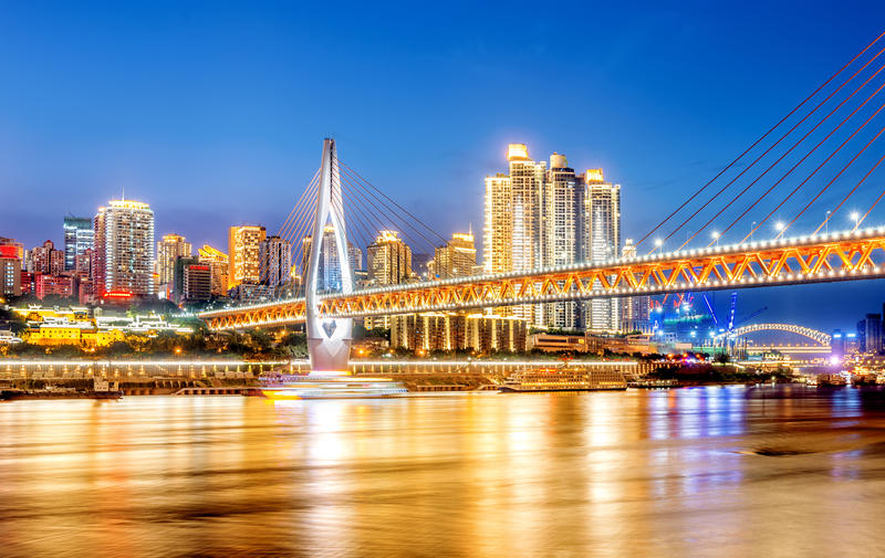 China Chongqing City Lights. Cityscape and skyline of downtown near water of chongqing at night stock images