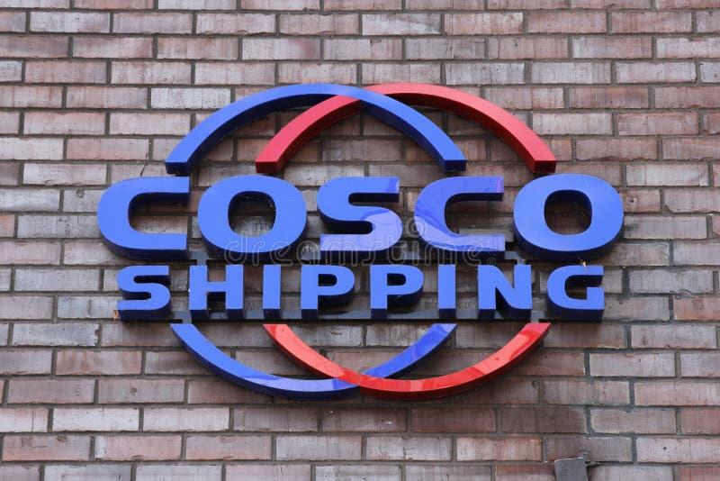 China COSCO Shipping nameplate. HAMBURG, GERMANY - JULY 8, 2018: Company nameplate at the Hamburg office of China COSCO Shipping. The company was formed by the royalty free stock photos