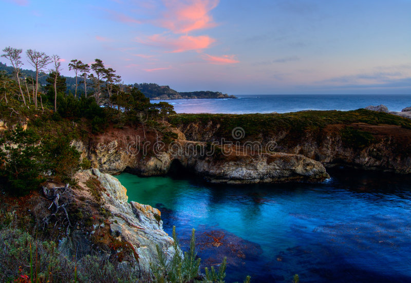 China Cove at Point Lobos. Sunset at China Cove at Point Lobos State Reserve in Northern California royalty free stock photography