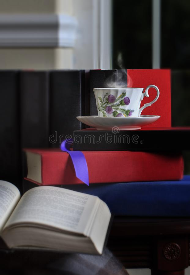 Steaming Cup of Tea and Books 2 stock photography