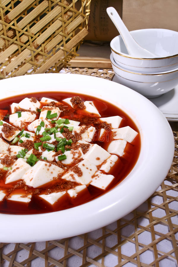 China delicious food-Fish spawn and tofu. Fish spawn and tofu in a basin stock photography
