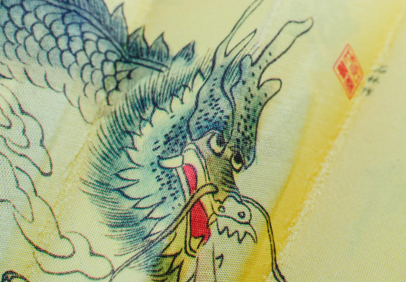 China dragon drawing. Isolated on a farbic background royalty free stock image
