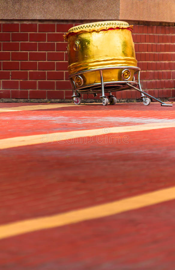 China Drum. Traditional gold Chinese Drum on sunny day stock images