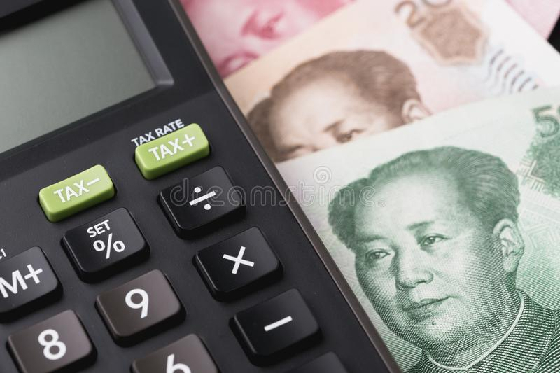 China financial, world new emerging market high growth country c. Oncept, closed up of calculator on China Yuan banknotes on table, major export and commerce stock photos