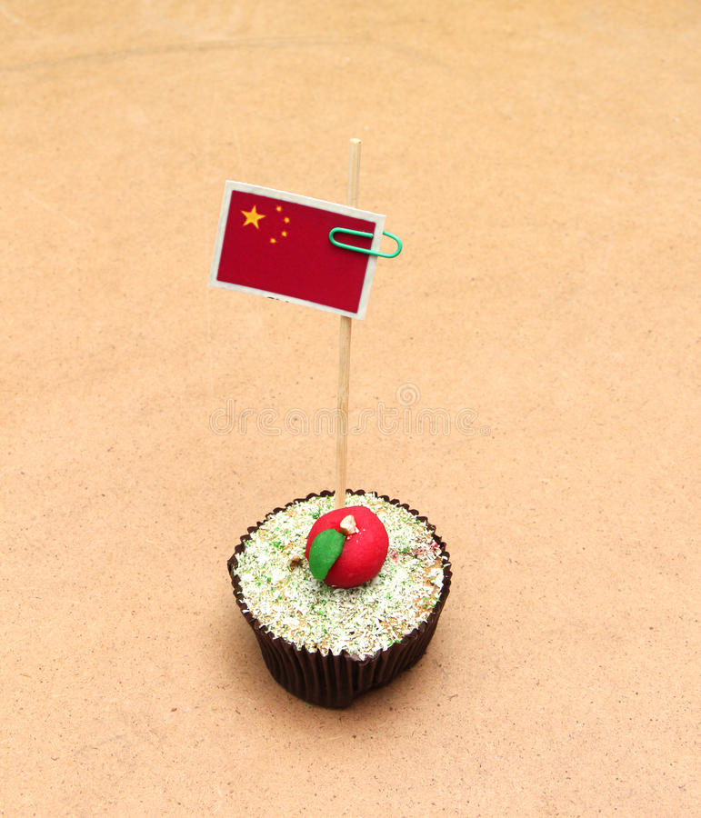 China flag on a apple cupcake,picture of a. Picture of a People`s Republic of China flag on an apple cupcake stock photo