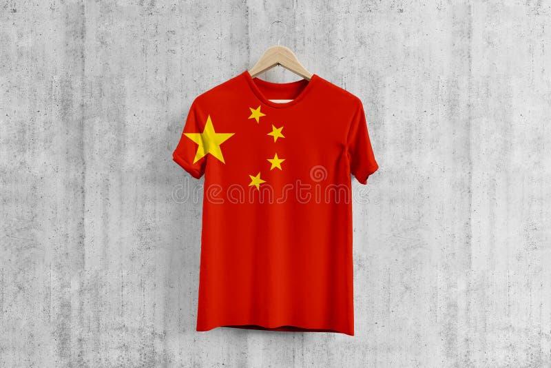 China flag T-shirt on hanger, Chinese team uniform design idea for garment production. National wear. 3D Rendering stock illustration
