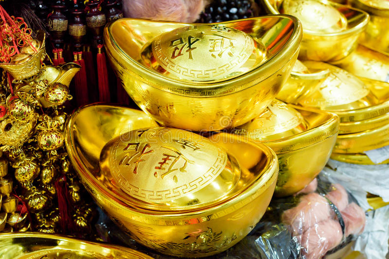 China gold. Chinese traditional golden coins are used as gifts during Spring Festival. They symbolize money and fortune. This picture can also be used when royalty free stock image
