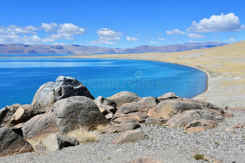 China. Great lakes of Tibet. Big stones of the store of the lake Teri Tashi Namtso in june.  royalty free stock photography