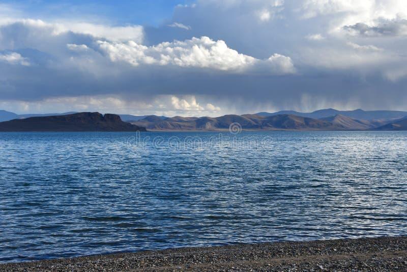 China. Great lakes of Tibet. Lake Teri Tashi Namtso in summer evening under a cloudy sky stock image