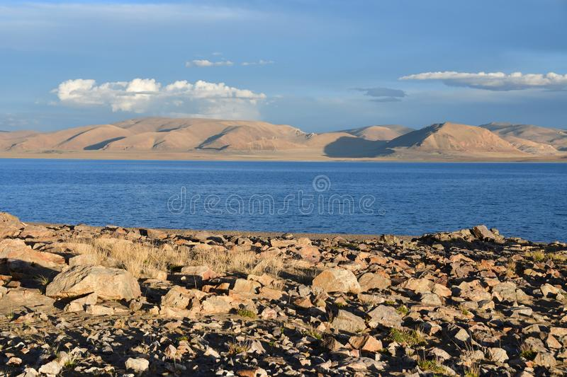 China. Great lakes of Tibet. Lake Teri Tashi Namtso in summer under a cloudy sky. China. Great lakes of Tibet.Lake Teri Tashi Namtso in summer  under cloudy sky royalty free stock images