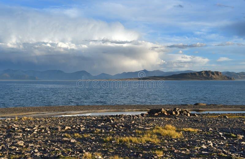 China. Great lakes of Tibet. Lake Teri Tashi Namtso in summer under a cloudy sky. China. Great lakes of Tibet.Lake Teri Tashi Namtso in summer  under cloudy sky royalty free stock image