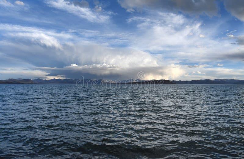 China. Great lakes of Tibet. Lake Teri Tashi Namtso in summer under a cloudy sky. China. Great lakes of Tibet.Lake Teri Tashi Namtso in summer  under cloudy sky royalty free stock photos