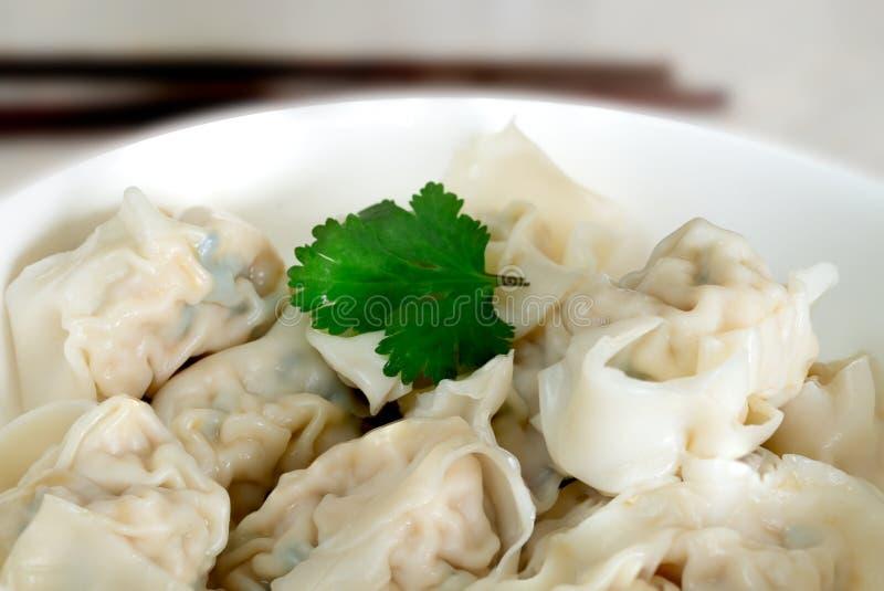 Shanghai style wonton dumplings in bowl royalty free stock photo