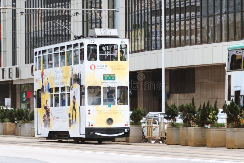 Double-decker tram on the street, popular among tourists mode of transport. China, Hong Kong, 2018-03-06: Double-decker tram on the street, popular among stock photos