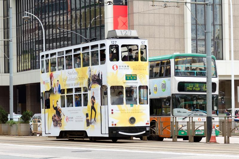 Double-decker trams on the street, popular among tourists mode of transport. China, Hong Kong, 2018-03-06: Double-decker trams on the street, popular among royalty free stock photography