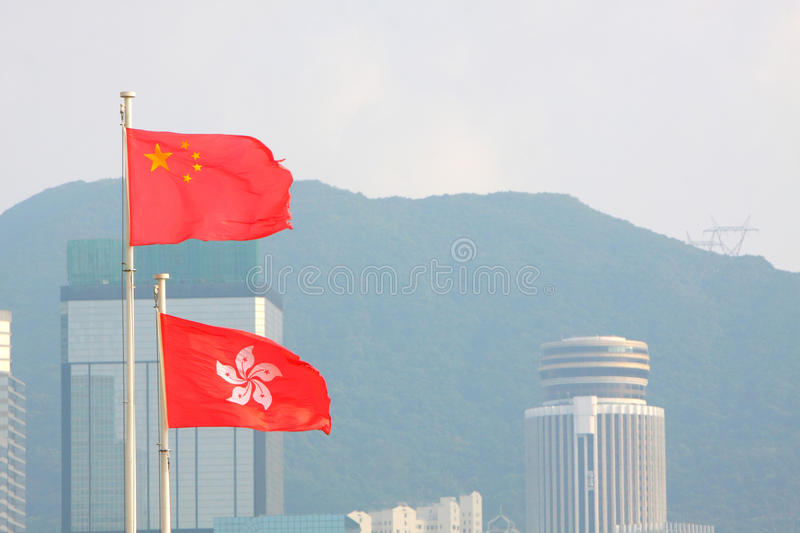 China & Hong Kong Flags stock photography