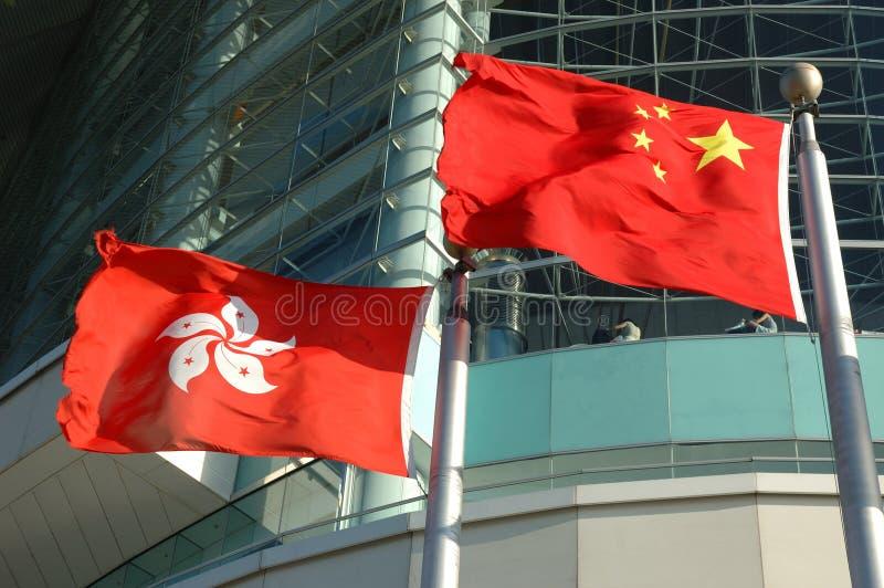 China and Hong Kong flags stock photo