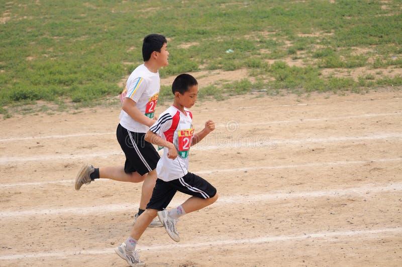 China: Juegos del atletismo del estudiante/raza del contador fotos de archivo libres de regalías