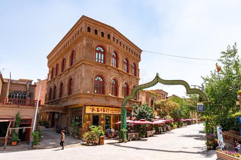 China Kashgar Old City 71. Kashgar Renovated Old City Shopping and Souvenir Street with Oriental Arched Bow Gate Entrance on a Sunny Blue Sky Day stock image