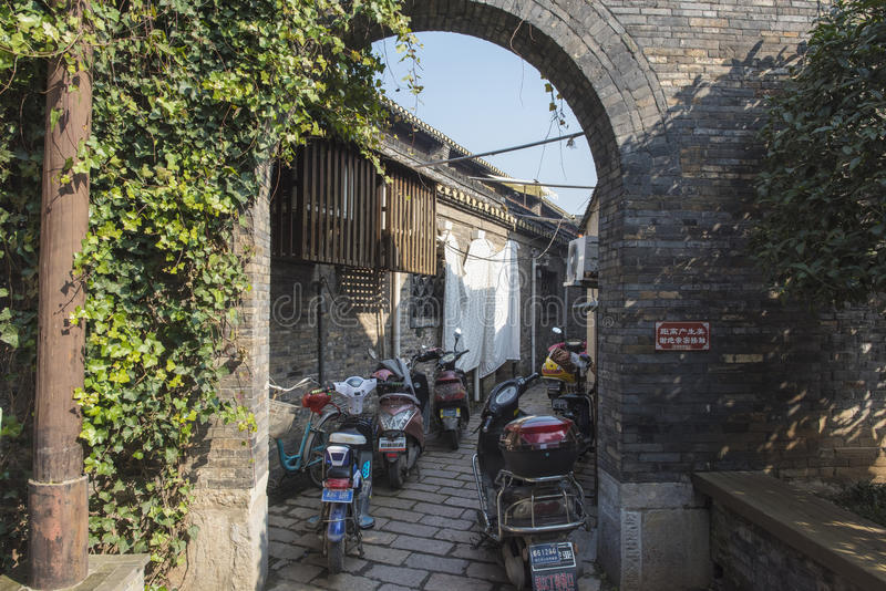 China lane, old house, round arch. China zhenjiang xinjin in an alley, the old house, the round arch, the motorcycle stock images