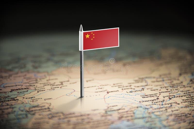 China markierte mit einer Flagge auf der Karte lizenzfreie stockfotos