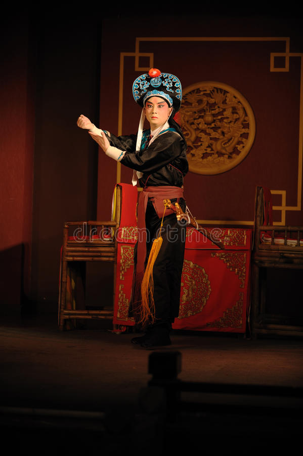 China opera actor with hat. And sword stock image
