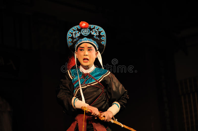 China opera actor with hat. And sword stock photography