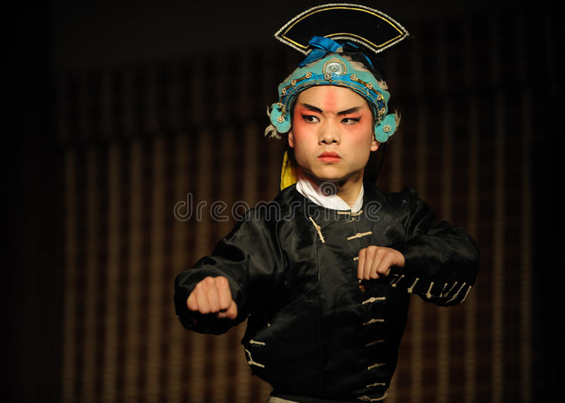 China opera actor with hat. In black stock photography