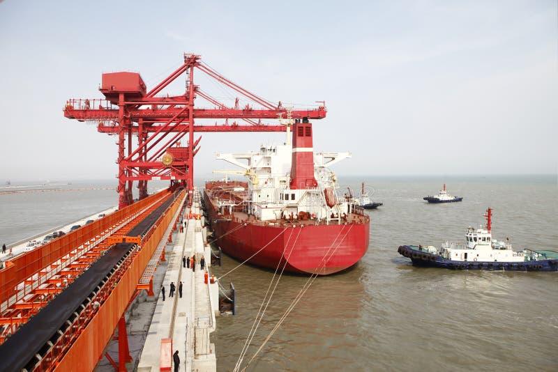 China Qingdao port and ton iron ore terminal. Because China, Europe and so sharply cut steel mill, steel price slump, Because China, Europe and so sharply cut stock image