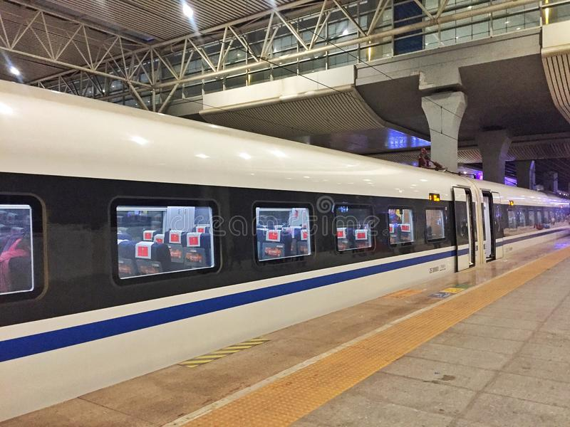 China Railway Highspeed Train in Chengdu Station. China Railway Highspeed Train arrives in Chengdu Station at night stock photos