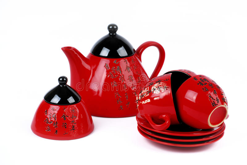 China red tea pot and tea cups . isolated royalty free stock photos